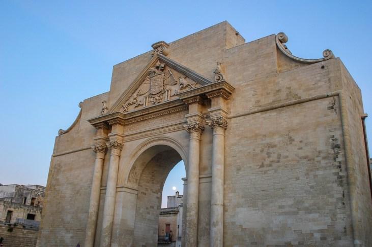 Porta Napoli gate and main entrance into Lecce Old Town in Puglia, Italy