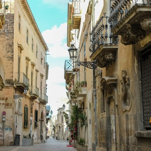 Opulent architecture on quiet lane in Lecce, Italy