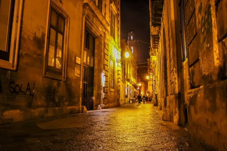 Empty street at night in Lecce, Italy