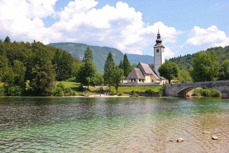 St. John the Baptist Church and bell tower on Lake Bohinj, Slovenia