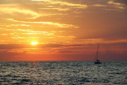 Sailboat on Adriatic Sea at sunset in Piran, Slovenia