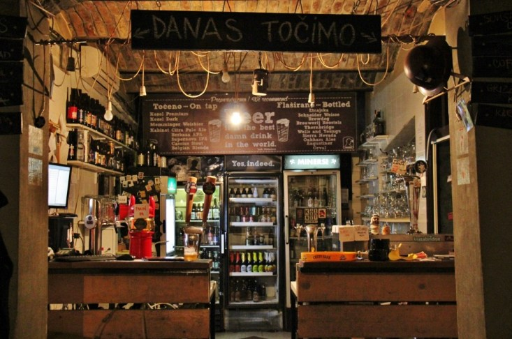 Cluttered bar at Miners Pub craft beer bar in Belgrade, Serbia