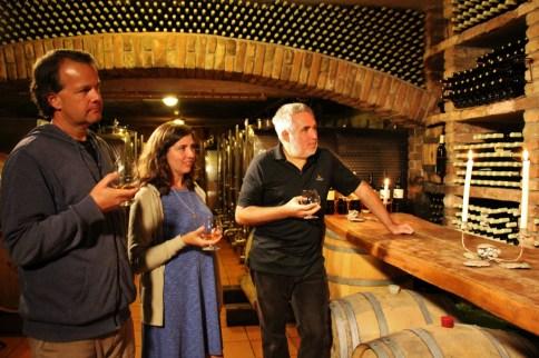 Tasting homemade brandy in cellar at Hisa Vina Cuk in Slovenia