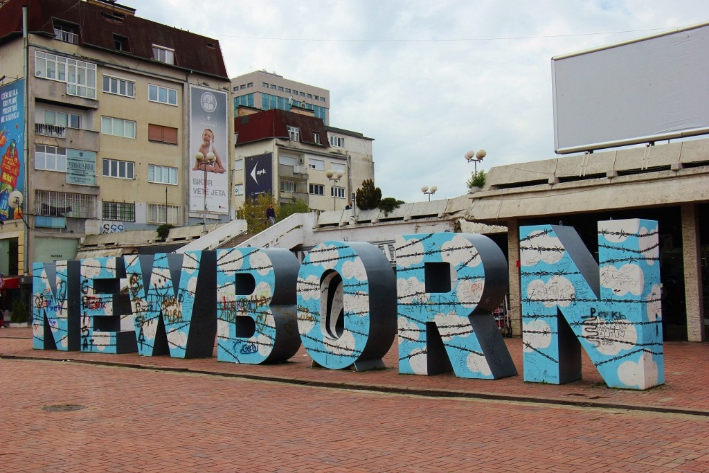 Newborn Monument painted with sky and barbed wire in Prishtina, Kosovo