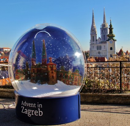 Giant snowglobe and Cathedral spires during Advent in Zagreb, Croatia