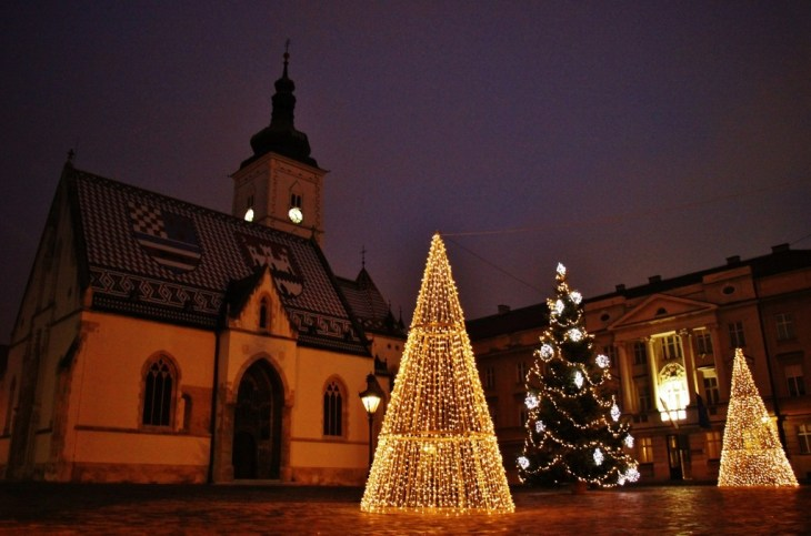 Lit trees on St. Mark's Square during Christmas in Zagreb, Croatia