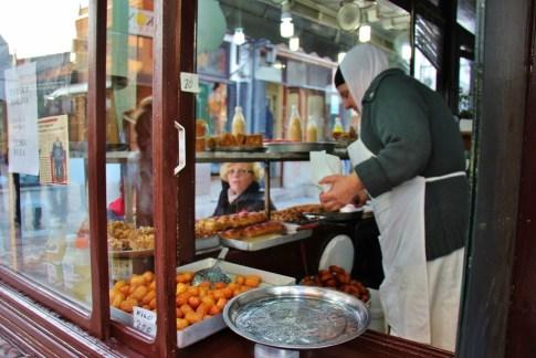 Lady sells Tulumba sweets in Old Bazaar, Skopje, Macedonia
