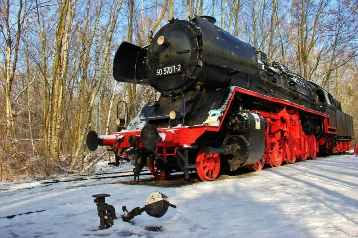 A 1940s steam train on display at Natur-Park Sudgelande in Berlin, Germany