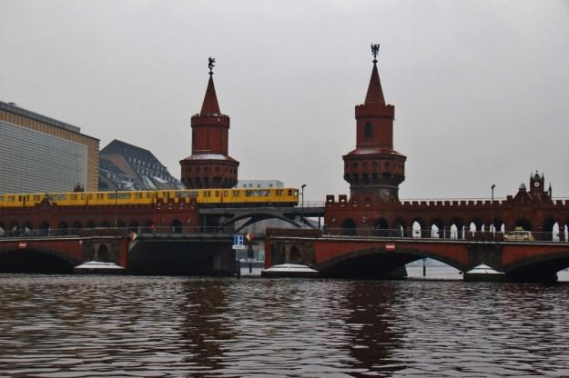 Train crosses Oberbaumbrucke Bridge in Berlin, Germany