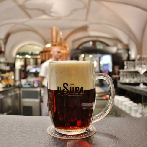 Glass mug of semi-dark beer at U Supa Brewery, Prague, Czech Republic