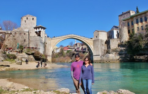 Posing for photo below Old Bridge in Mostar, Bosnia-Herzegovina