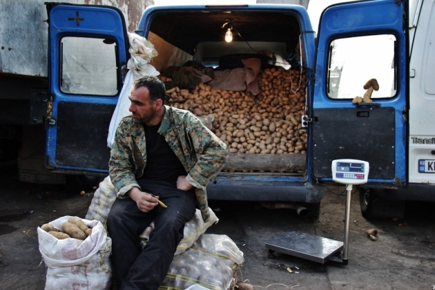 Man sells potatoes from his van at Dezerter Market, Tbilisi, Georgia