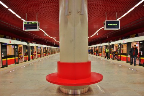Red bench at Rondon Daszynskiego Metro Station in Warsaw, Poland