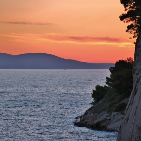 Hazy sunset behind St. Peter's Peninsula, Makarska, Croatia