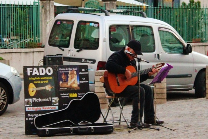 Man sings Fado in Street in Lisbon, Portugal