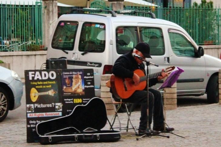 Man sings Fado in Street in Lisbon, Portugal