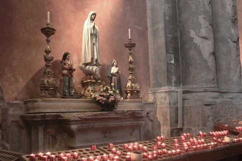 Lit candles at Sao Domingos Church in Lisbon, Portugal