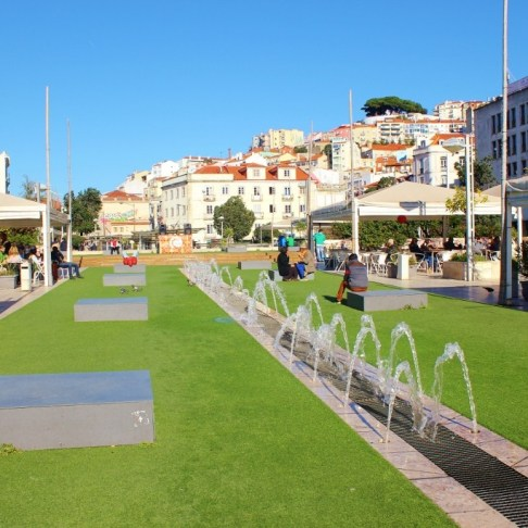 Green lawn and fountains at the Martim Moniz Park in Lisbon, Portugal