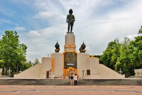 Large statue of King Rama VI at Lumphini Park in Bangkok, Thailand