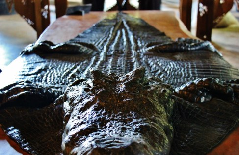 Alligator skin table runner at Black House Museum, Baan Dam, in Chiang Rai, Thailand