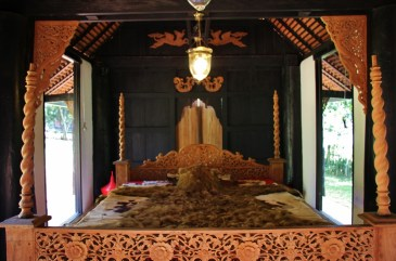 A Bear skin blanket on a bed at Black House Museum in Chiang Rai, Thailand