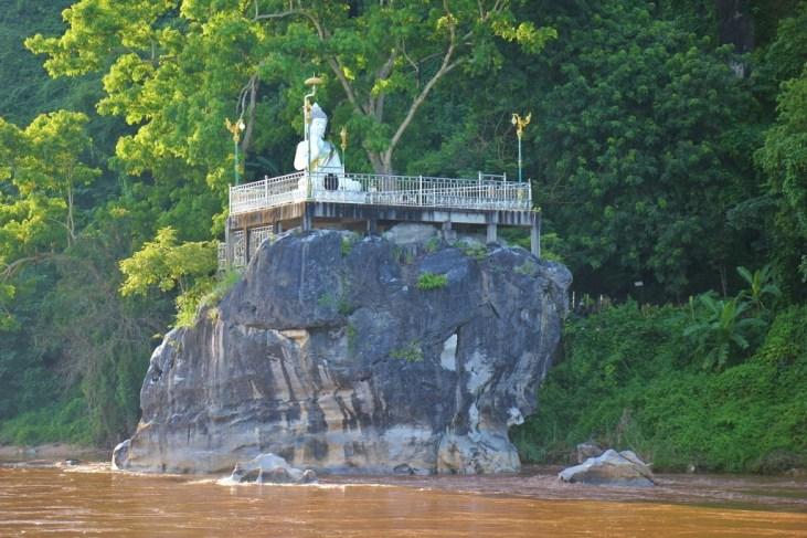 A Buddha Statue on the Kok River at Chiang Rai Beach in Chiang Rai, Thailand