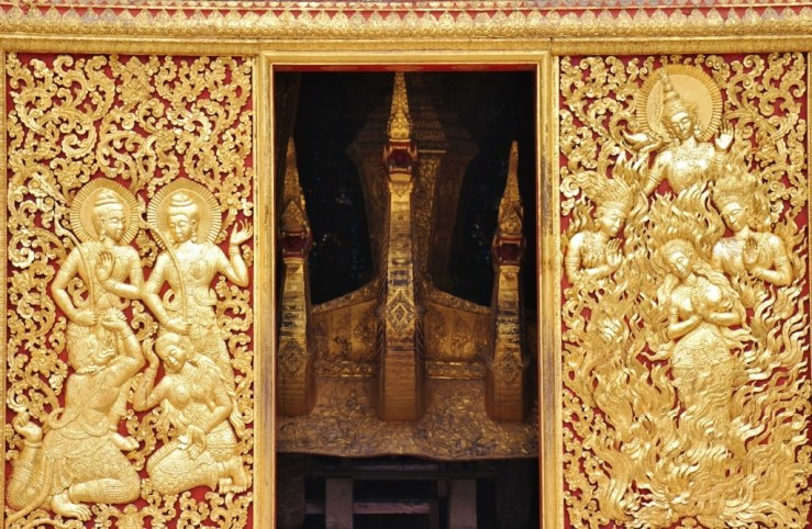 Golden doors and Naga heads at temple at Wat Xieng Thong in Luang Prabang, Laos