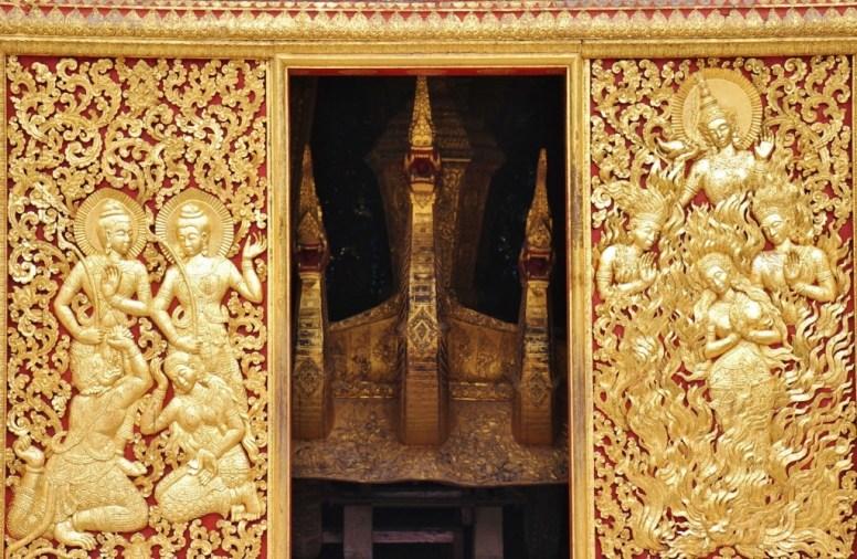 Golden doors and Naga heads at temple at Wat Xieng Thong in Luang Prabang, Laos
