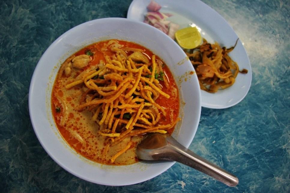 Khao Soi, famous Northern Thailand cuisine, at Khao Soi Phor Jai in Chiang Rai, Thailand