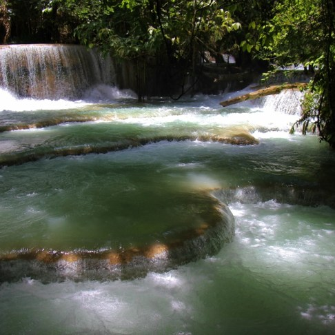 Flowing waterfalls at Kuang Si Waterfalls in Luang Prabang, Laos