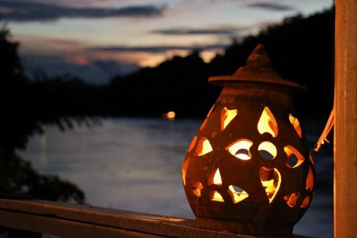 Watching sunset from a Mekong riverside cafe in Luang Prabang, Laos