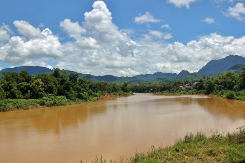 Nam Khan River and distant mountains on clear day in Luang Prabang, Laos