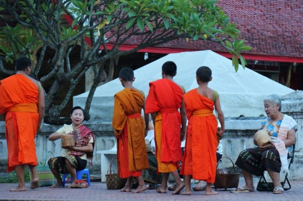 Young novice monks at Morning Almsgiving ceremony in Luang Prabang, Laos
