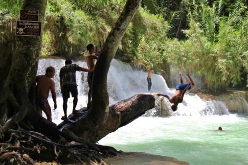 Man flips into water at Kuang Si Waterfalls in Luang Prabang, Laos