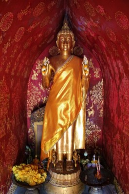 Statue in small temple at Wat Xieng Thong in Luang Prabang, Laos
