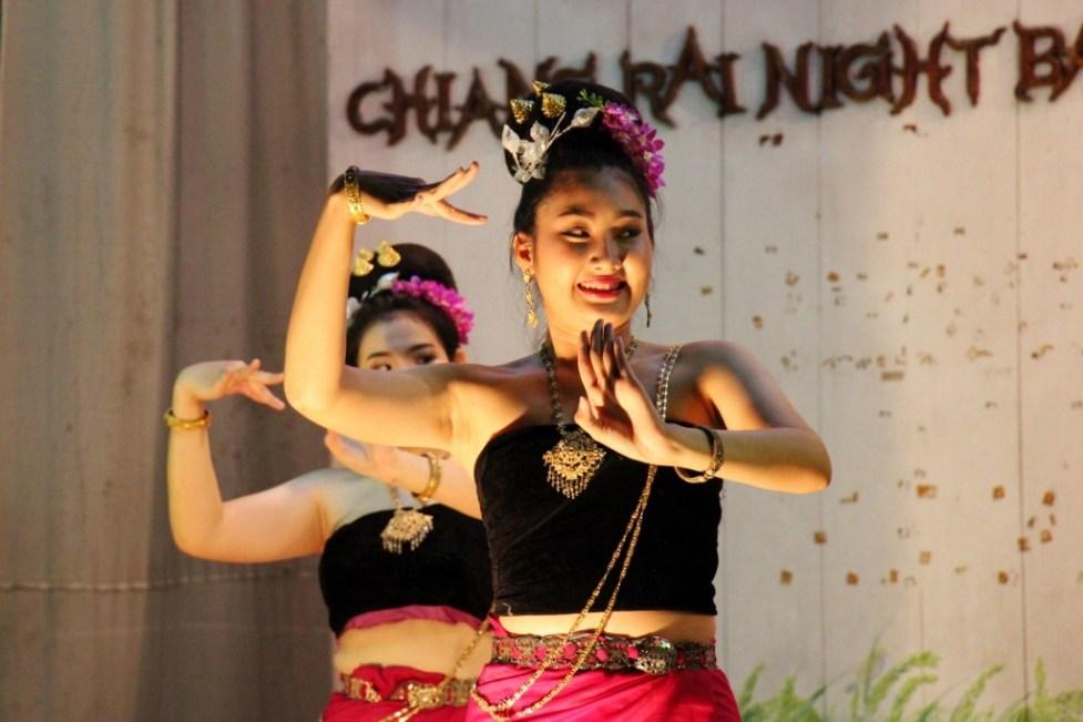 Dancers perform traditional Thai dance at Night Market in Chiang Rai, Thailand