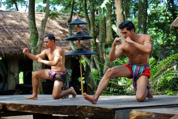 Two warriors perform at Black House Museum, Baan Dam, in Chiang Rai, Thailand