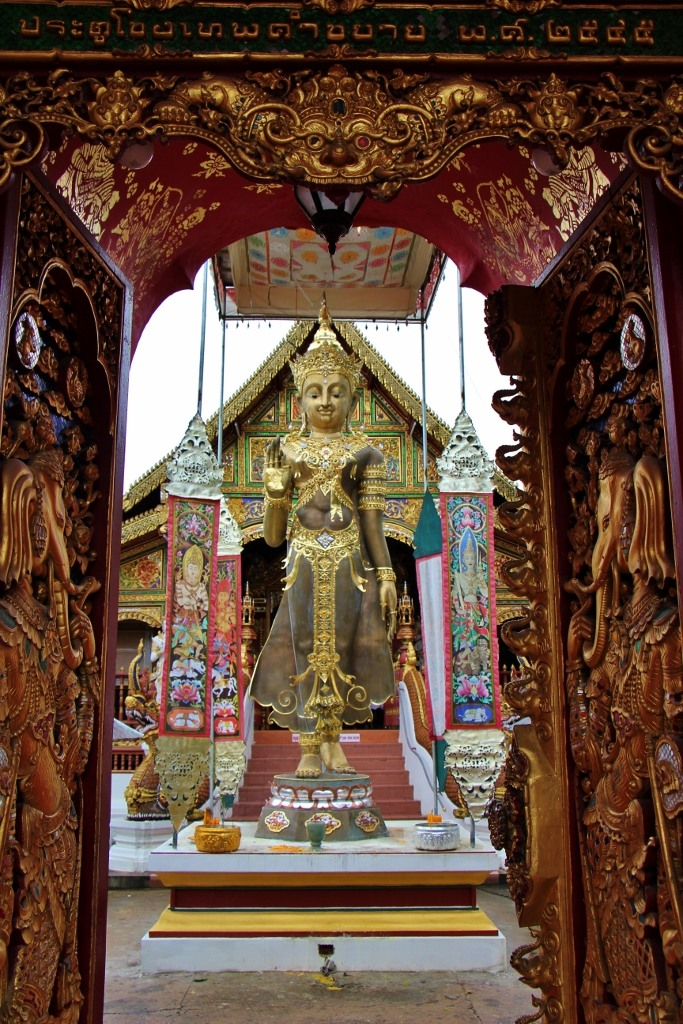 Statue at Wat Ming Muang entrance in Chiang Rai, Thailand