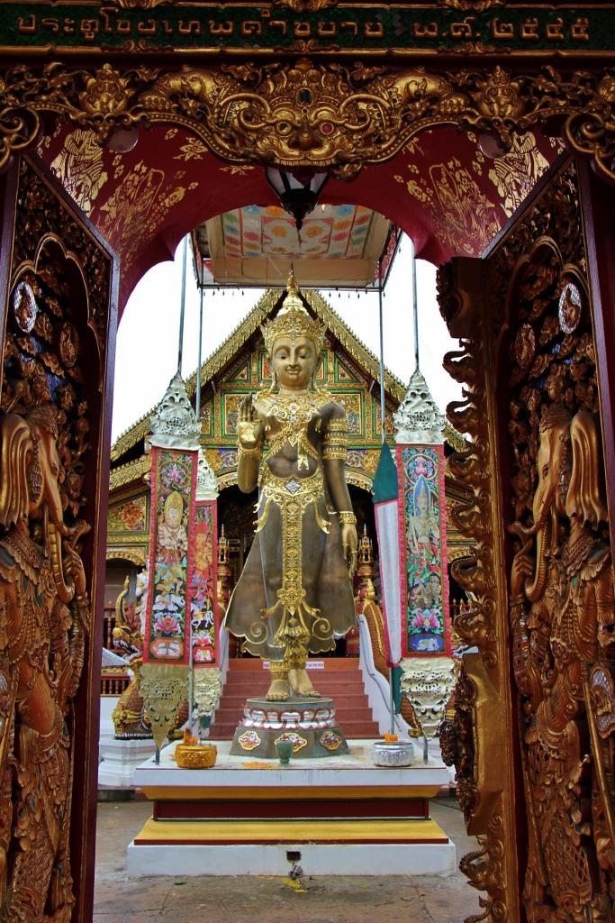 Statue at Wat Ming Muang entrance in Chiang Rai, Thailand