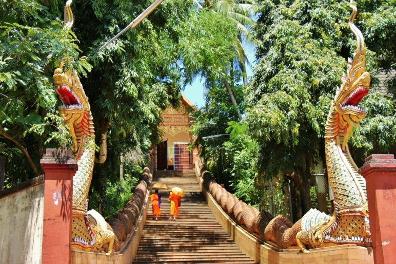 Monks climbs stairs to Wat Phra That Chom Thong in Chiang Rai, Thailand