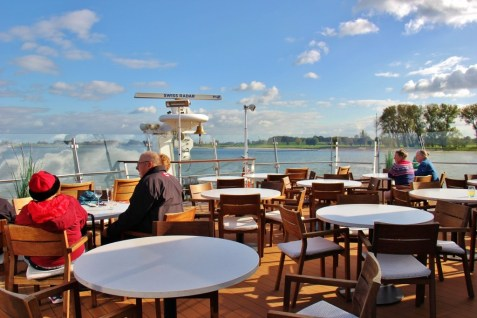 Tables at bow of Viking Magni longship on Amsterdam to Budapest Cruise