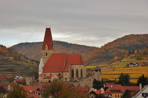 Stone church at center of riverside village in Wachau Valley, Austria