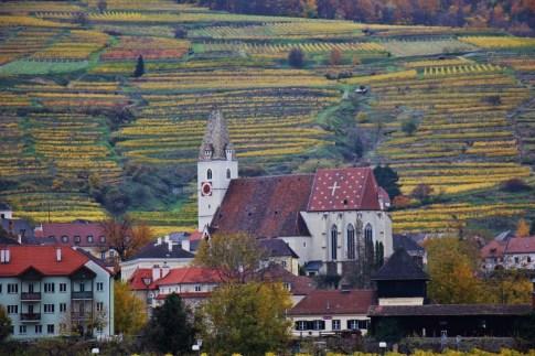 Quaint church and hillside vineyards in Wachau Valley, Austria