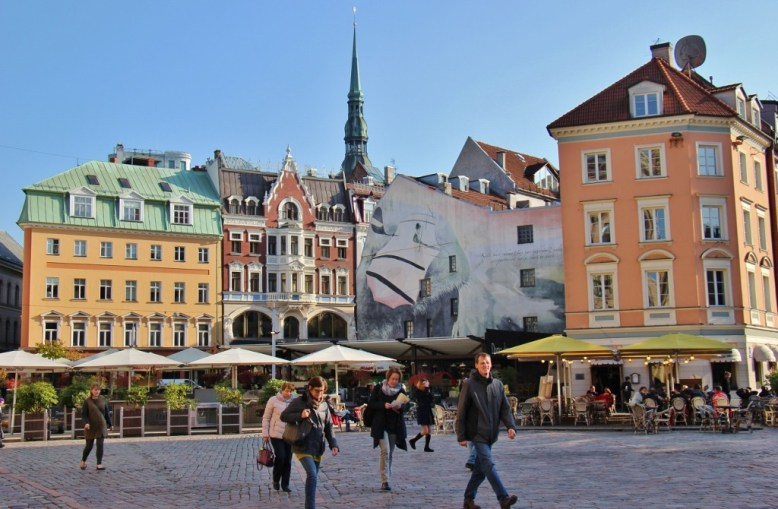 People walking through Dome Square in Old Town Riga, Latvia