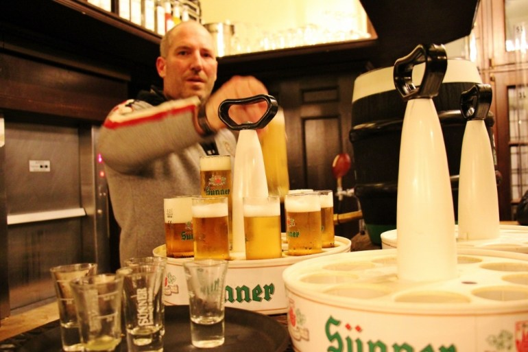 Bartender pouring Kolsch Beer at brew house in Cologne, Germany
