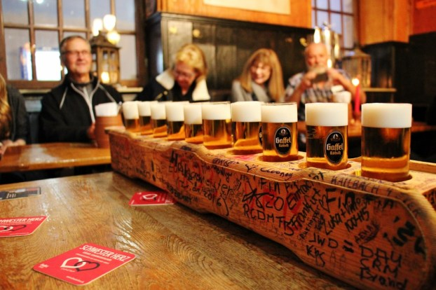 Wooden tray of Kolsch Beer in Cologne, Germany