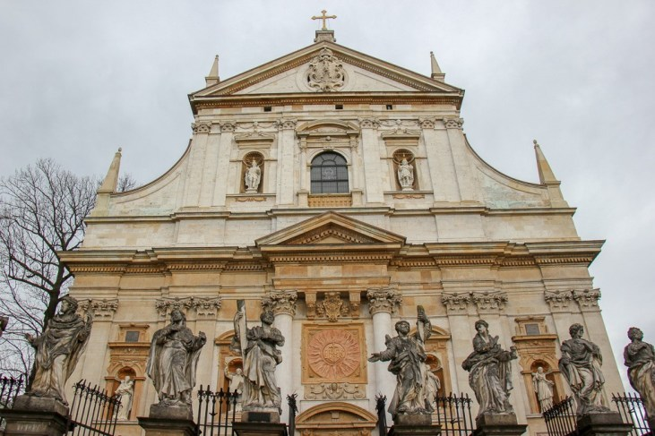 12 Apostles Statues line gate of Church of St. Peter and Paul in Old Town Krakow, Poland