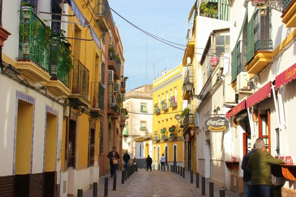 Colorful street in Triana neighborhood in Seville, Spain