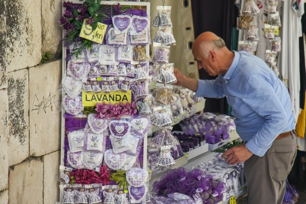 Man sells lavender products inside Silver Gate in Diocletian's Palace in Split, Croatia