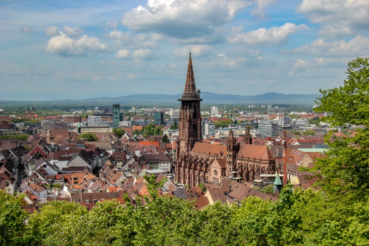 Cathedral and city view from scenic viewpoint on Schlossberg in Freiburg, Germany